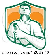 Retro Male Barber Holding Clippers In A Green White And Orange Shield