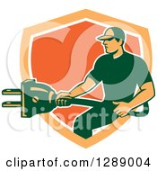 Clipart Of A Retro Male Electrician Holding A Giant Plug In An Orange And White Shield Royalty Free Vector Illustration