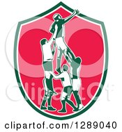 Clipart Of A Retro Rugby Union Player Catching Lineout Ball In A Green White And Pink Shield Royalty Free Vector Illustration
