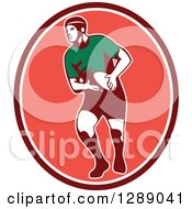 Clipart Of A Retro Male Rugby Player Passing The Ball In A Maroon White And Pink Oval Royalty Free Vector Illustration
