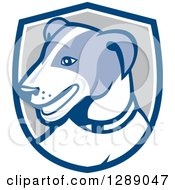 Clipart Of A Retro Cartoon Jack Russell Terrier Dog In A Blue White And Gray Shield Royalty Free Vector Illustration