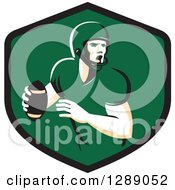 Clipart Of A Retro Male American Football Player Throwing In A Black And Green Shield Royalty Free Vector Illustration