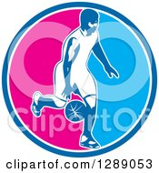 Clipart Of A Basketball Player Dribbling In A Blue White And Pink Circle Royalty Free Vector Illustration