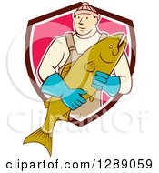 Clipart Of A Cartoon Male Fishmonger Holding A Catch And Emerging From A Maroon White And Pink Shield Royalty Free Vector Illustration