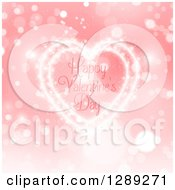 Clipart Of Happy Valentines Day Text Inside A Heart Of Light Over Bokeh And Pink Royalty Free Vector Illustration by KJ Pargeter