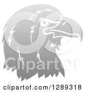 Clipart Of A Gradient Gray Eagle Or Falcon Head In Profile Royalty Free Vector Illustration