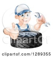 Poster, Art Print Of Happy Brunette White Mechanic Man Holding A Wrench And Thumb Up Over A Tire