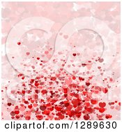 Clipart Of A Background Of Pink And Red Valentine Hearts Some Faded Royalty Free Vector Illustration by vectorace