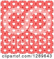 Clipart Of A Seamless Valentines Day Pattern Background Of Red And White Hearts On Pink Royalty Free Vector Illustration