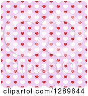 Clipart Of A Seamless Valentines Day Pattern Background Of Red And White Hearts On Purple Royalty Free Vector Illustration