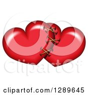 Clipart Of A Red Valentine Yearts Sewn Together Royalty Free Vector Illustration