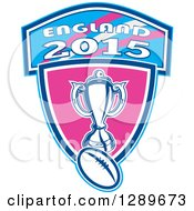 Clipart Of A Retro Rugby Ball And Trophy Over A Pink And Blue England 2015 Shield Royalty Free Vector Illustration