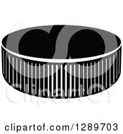 Clipart Of A Black And White Hockey Puck 5 Royalty Free Vector Illustration