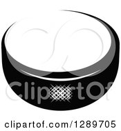 Clipart Of A Black And White Hockey Puck 3 Royalty Free Vector Illustration