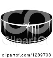 Clipart Of A Black And White Hockey Puck 6 Royalty Free Vector Illustration