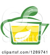 Clipart Of A Green And Yellow Tea Cup With A Leaf 11 Royalty Free Vector Illustration