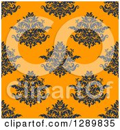 Clipart Of A Background Pattern Of Seamless Navy Blue Damask On Orange Royalty Free Vector Illustration