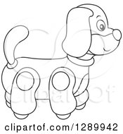 Clipart Of A Black And White Rolling Dog Toy Royalty Free Vector Illustration