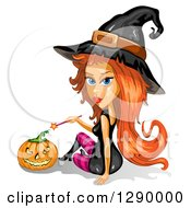 Clipart Of A Red Haired Attractive Halloween Witch Holding A Wand By A Jackolantern Pumpkin Royalty Free Vector Illustration