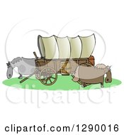 Oregon Trail Covered Wagon With Horses Grazing Around It