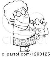 Cartoon Clipart Of A Black And White Granny Senior Woman Holding A Dog Royalty Free Vector Line Art Illustration