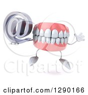3d Mouth Teeth Mascot Jumping And Holding An Email Arobase At Symbol