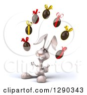 Clipart Of A 3d White Bunny Rabbit Facing Slightly Left And Juggling Chocolate Easter Eggs Royalty Free Illustration by Julos
