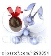 Clipart Of A 3d Blue Bunny Rabbit Holding Up A Chocolate Easter Egg Royalty Free Illustration