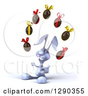 Clipart Of A 3d Blue Bunny Rabbit Facing Slightly Left And Juggling Chocolate Easter Eggs Royalty Free Illustration by Julos