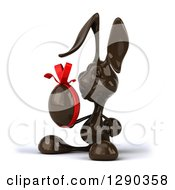 Clipart Of A 3d Dark Chocolate Easter Bunny Facing Left And Holding An Egg Royalty Free Illustration