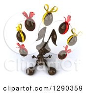 Clipart Of A 3d Dark Chocolate Easter Bunny Looking Up And Juggling Eggs Royalty Free Illustration by Julos