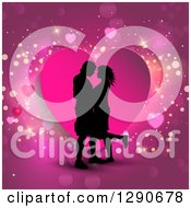 Clipart Of A Black Silhouetted Couple Kissing Over A Pink Heart And Sparkly Background Royalty Free Vector Illustration by KJ Pargeter