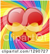 Shiny Red Valentine Love Heart Wrapped Ina Yellow Bow Over A Rainbow Swirl