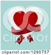 Red Valentine Love Heart Over A Patterned Doily With A Red Ribbon Over Turquoise