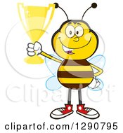 Clipart Of A Happy Honey Bee Holding Up A Gold Trophy Royalty Free Vector Illustration by Hit Toon
