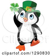 Clipart Of A Cute St Patricks Day Leprechaun Penguin Holding A Four Leaf Clover Royalty Free Vector Illustration