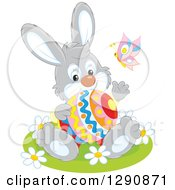 Clipart Of A Happy Gray Bunny Rabbit Holding An Easter Egg And Waving Royalty Free Vector Illustration