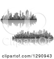 Multi Toned Gray Silhouetted City Skylines And Reflections