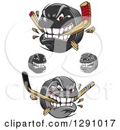 Clipart Of Aggressive Hockey Puck Characters Some Biting Sticks Royalty Free Vector Illustration