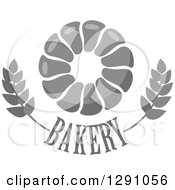 Clipart Of A Grayscale Pull Apart Croissant Or Monkey Bread Ring Over Bakery Text And Wheat Royalty Free Vector Illustration