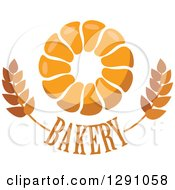 Clipart Of A Pull Apart Croissant Or Monkey Bread Ring Over Bakery Text And Wheat Royalty Free Vector Illustration