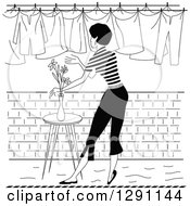 Clipart Of A Black And White Rear View Of A Retro Woman Hanging Laundry Out To Dry Royalty Free Vector Illustration by pauloribau