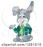 Clipart Of A Happy Presenting Business Easter Rabbit Royalty Free Vector Illustration