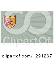 Clipart Of A Retro Attacking Viper Snake And Green Rays Background Or Business Card Design Royalty Free Illustration