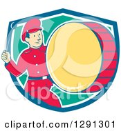 Clipart Of A Retro Cartoon Marching Band Drummer Man Emerging From A Blue White And Turquoise Shield Royalty Free Vector Illustration by patrimonio