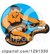 Retro Muscular Man Wrestling A Boa Constrictor Snake Over A Blue Circle