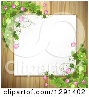Blank White Sign Or Paper Over Wood With St Patricks Day Clovers And Flowers