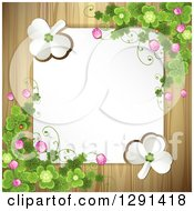 Blank White Sign Or Paper Over Wood With St Patricks Day Clovers White Shamrocks And Flowers