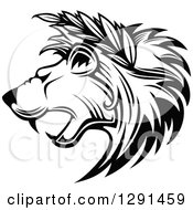 Clipart Of A Black And White Roaring Lion Head In Profile With Leaves In His Mane Royalty Free Vector Illustration