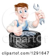 Clipart Of A Happy Middle Aged Brunette White Mechanic Man Holding A Wrench And Thumb Up Over A Tire Royalty Free Vector Illustration